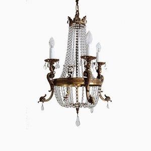 Lámpara de araña italiana vintage de bronce y cristal, años 50