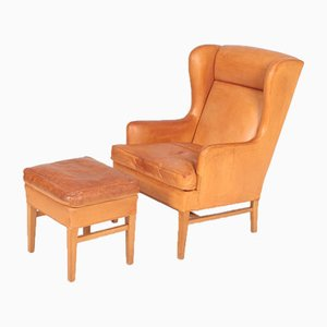 Mid-Century Danish Patinated Leather Lounge Chair and Ottoman Set, 1950s