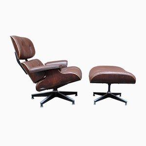 Sillón modelo 670 vintage de palisandro y otomana modelo 671 de Charles & Ray Eames para Herman Miller, años 60