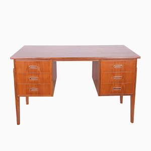 Teak has been cleaned and painted in an oak mordant and polished with a lacquer