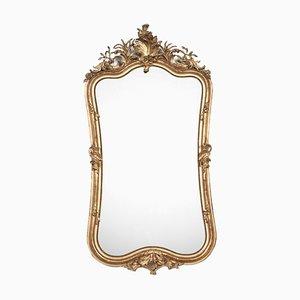 Espejo Rococó antiguo grande de madera dorada