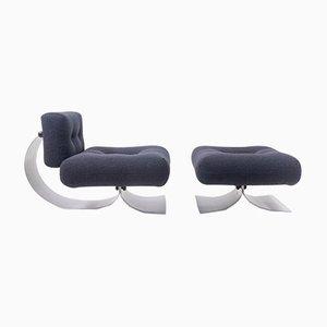 Poltrona e poggiapiedi di Oscar Niemeyer per Mobilier International, anni '70