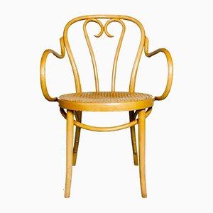 Vintage Armlehnstuhl aus Rattan, 1960er