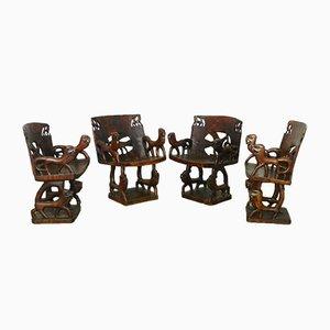 Antike afrikanische Stühle aus geschnitztem Holz, 4er Set