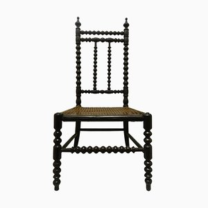 Antiker französischer Kinderstuhl aus Schilfrohr
