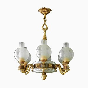 French Neoclassical Gilt Bronze & Crystal Lions Head Chandelier from Palwa, 1960s