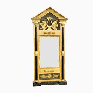 Espejo Biedermeier de abedul, madera ennegrecida y estuco dorado, años 20
