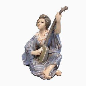 Figura de geisha oriental de porcelana de Jens Peter Dahl-Jensen, años 20
