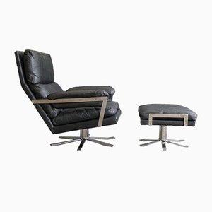 Juego de sillón y otomana vintage de cuero negro de Arne Norell para Vatne Lenestolfabrikk, años 60