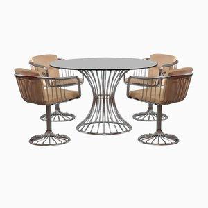 Italienische Chrom Armlehnstühle und Tisch von Rinaldi Gastone, 1970er, 5er Set