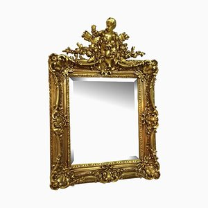 Antique Gilt Florentine Mirror with a Boy Figure Crowning