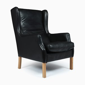 Mid-Century Danish Black Leather Wing Armchair by Georg Thams, 1960s