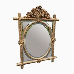 Antiker französischer Spiegel mit Schnitzereien aus geschnitztem Holz & Gesso & ovalem Kreuzrahmen