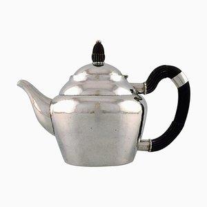 Antike Teekanne aus gehämmertem Silber mit Griff aus Ebenholz von Georg Jensen