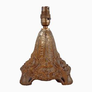 Lampada ad olio antica in ghisa