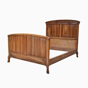 Antique French Art Nouveau Bed in Carved Walnut with Blooming Shrubs Theme by Louis Majorelle