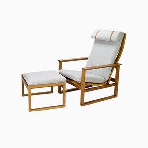 Modell 2254 Armlehnstuhl und Modell 2248 Fußhocker von Børge Mogensen für Fredericia, 1950er