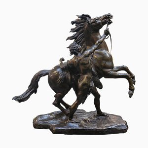 Bronze Sculpture Representing a Man Taming a Horse
