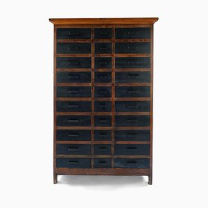 Brown and Black Wooden Cabinet with 30 Drawers