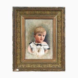 Retrato de un niño pintando sobre porcelana