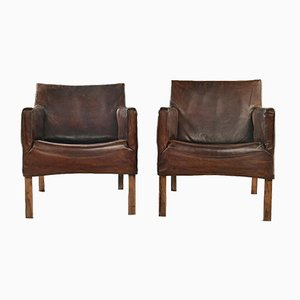 Pair of leather armchairs by Gerard van den Berg, Set of 2