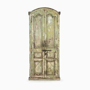 Tür aus patiniertem Holz