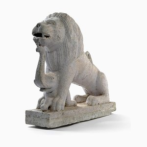 Statue of a Lion with a Small Elephant