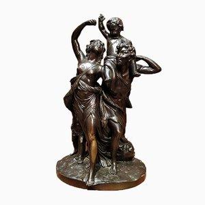 Skulptur aus Bronze, die eine Familie darstellt
