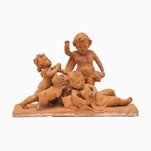 19th Century Belgian Ceramic Sculpture with a Group of Playing Putti's