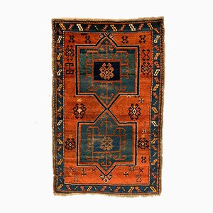 Vintage Kazak Green, Blue, and Rust Fachralo Rug, 1930s