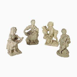 Figuras italianas del siglo XIX esmaltadas en gres de barro cocido. Juego de 4