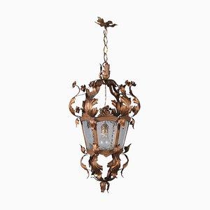 Lámpara de araña italiana de hierro dorado