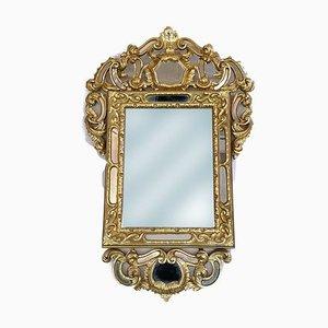 Specchio antico in legno placcato in oro intagliato a mano