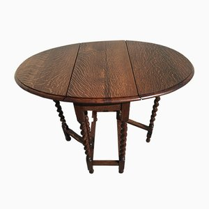 19th Century Folding Oval Table with Snail-Shaped Legs
