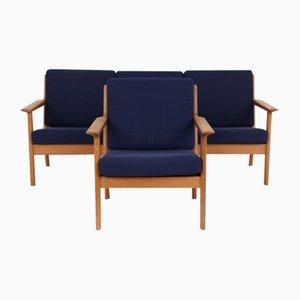 Sofá de tres plazas y butaca modelo GE265 de Hans J. Wegner para Getama, años 70. Juego de 2