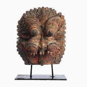 Escultura de máscara india de madera y policromo, década de 1850