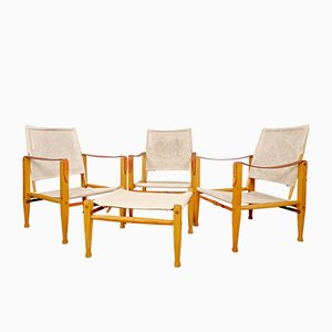 Danish Safari Lounge Chairs and Footstool Set by Kaare Klint for Rud. Rasmussen, 1960s, Set of 4