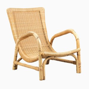 Vintage Rattan Armlehnstuhl von Arco