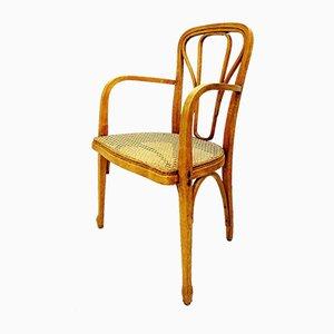 Antiker Armlehnstuhl aus Bugholz & Schilfrohr von Thonet