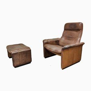 Vintage Modell DS50 Sessel und Fußhocker aus Leder von de Sede, 1970er