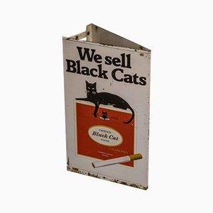 Señal de tienda de cigarrillos en forma de gato negro, años 70