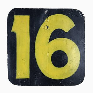 Number 16 Hand-Painted in Yellow on a Dark Background, England, 1940s