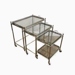 French Neoclassical Style Silvered Brass Nesting Tables on Casters by Maison Bagués, 1940s