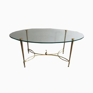 French Neoclassical Oval Brass Coffee Table with Dolphin On Center of the Stretcher & Glass Top by Maison Jansen, 1940s