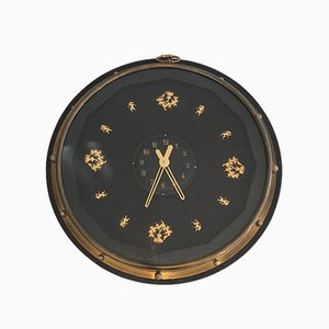 French Black and Gilt Wall Clock in the style of Jacques Adnet, 1950s