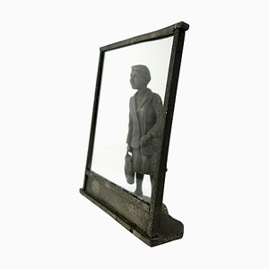 Vintage Zinc Statue of a Flemish Lady Who is Window Shopping at UNIC Supermarket