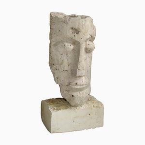 Scultura cubista in pietra intagliata raffigurante la testa di Mihai Vatamanu, anni '60