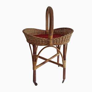 Deutscher Vintage Beistelltisch aus Bambus & rotem Kunststoff auf Rollen, 1960er