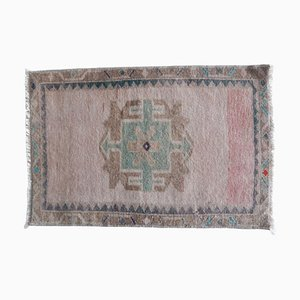 Small Turkish Hand-Knotted Distressed Low Pile Faded Yastik Rug, 1970s
