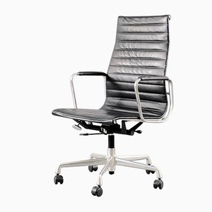 Mid-Century Chrome and Leather Model EA 119 Swivel Chair by Charles & Ray Eames for Vitra